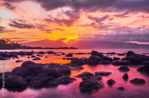Purple Sunset View with Ponds, Mountains and Dramatic Clouds in Maui Hawaii