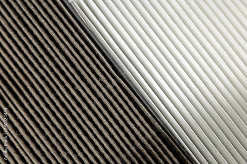 Photo Close up, clean and dirty cabin air filter for car