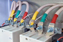 Connection Of Electrical Cables And Wires To Industrial Magnetic Starters. Cables Are Marked With Color. Bolted Connection With Nut. Modern Production Of Electric Cabinets. Electricity Distribution.