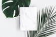 Leinwandbild Motiv Summer composition. Tropical palm leaves, marble paper blank on pastel gray background. Summer concept. Flat lay, top view, copy space