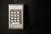 Secure Password On Keyboard For Opening Home House Door Isolated On Black Background. Password Code Security Keypad System Protected In Public Building. Security Code Combination To Unlock The Door