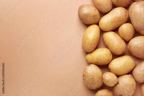 Obraz na płótnie Raw potato on color background