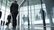 4K Diverse team of business people walking through large modern office building.