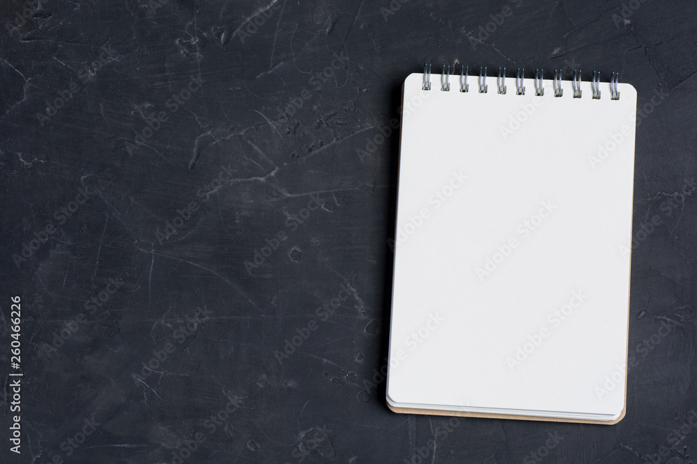 Fototapety, obrazy: Blank notepad sheet on a dark surface. Nice mock up for designers art work.