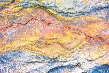 Fototapeta Architektura Colourful mosaics or rocks - layered sedimentary minerals exposed by sea - textured background