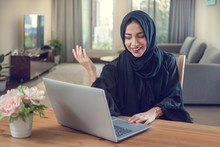 Smiling Young Arabian Woman Using Laptop At Home