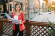 Portrait of business women in feeling of concentrate stress and see stand and hold the paper file sheet in the outdoor pedestrian walk way with the city space of exterior modern facade building
