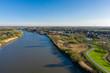 The Scheldt river reaching the town of Baasrode, in East Flanders, Belgium