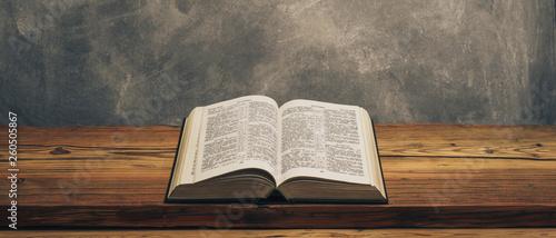 Obraz na plátně  Open Holy Bible on a old oak wooden table