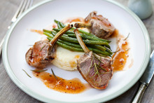 Lamb Rack With Mashed Potatoes, Green Beans And Red Wine Jus