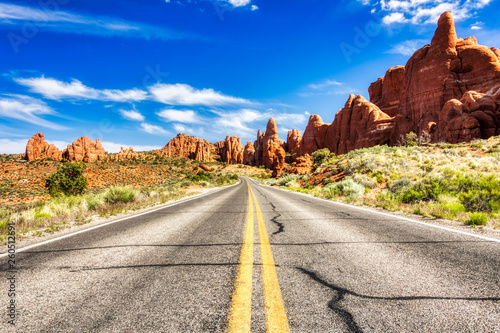 Canvas Prints Arizona Driving through the-Desert with Monument Rock along the Road During Sunny Day, Arches NP