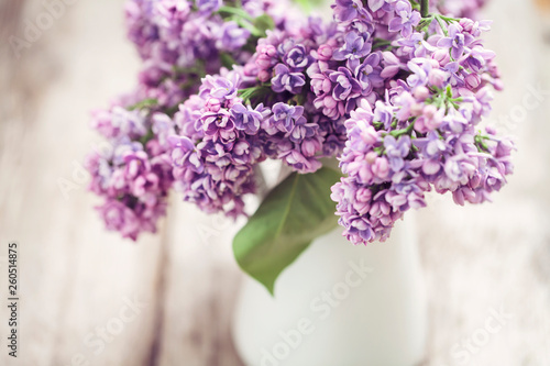 Lilac flowers in white vase