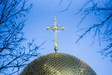 Golden Orthodox Cross On The Dome Of The Church.