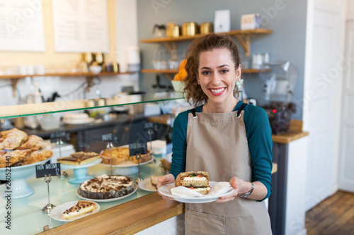 Fotografering Waitress ready to serve food in cafe