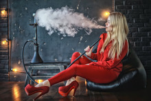 Girl Smokes  Hookah / Beautifu...