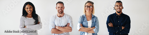 Fotografia  Diverse group of smiling colleagues standing with their arms cro