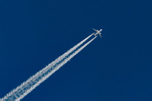 Airplanes Leaving Contrail Trace On A Clear Blue Sky.