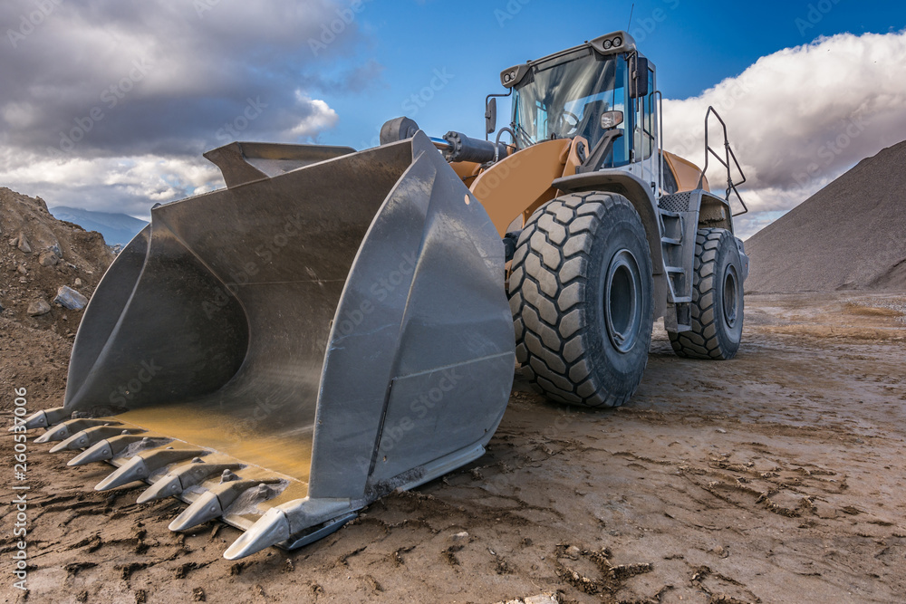Fototapety, obrazy: Bulldozer type excavator working in a rock and stone processing plant for gravel processing