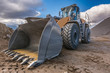 canvas print picture - Bulldozer type excavator working in a rock and stone processing plant for gravel processing