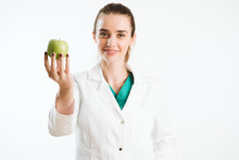 Young Nurse Holding An Apple, ...