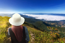 Girl Wearing A Hat Tourists And Walking Guides Visit Kew Mae Pan Nature Trail Sky With White Mist And Sunrise, Doi Inthanon National Park, ChiangMai, Thailand