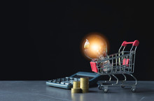 Energy Saving Light Bulb With Shopping Cart Financial And Shopping Concept And Copy Space For Insert Text.