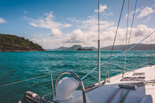 Sailboat Sailing On A Warm Beautiful Day In The Whitsunday Islands On The Great Barrier Reef In Australia.