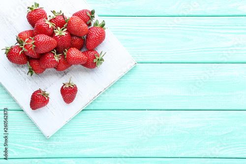 Fotografie, Obraz  Fresh strawberries with cutting board on wooden table