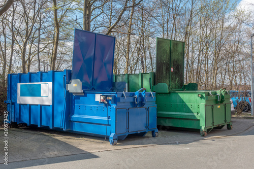 Fotografia, Obraz  two large garbage compactors standing on a hospital site