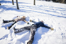 Two Friends Making Snow Angels...