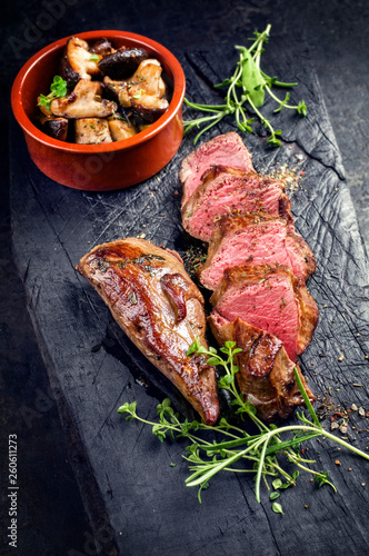 Traditional barbecue aged sliced venison sirloin with mushroom and herbs as clos Wallpaper Mural