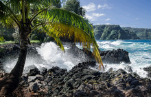 Rocky Shore In Hawaii:  Rough Surf Crashes Against Volcanic Rocks On The North Coast Of Maui.