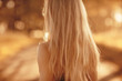 Leinwanddruck Bild - blonde long hair nature summer / happy adult girl with developing in the wind long blonde hair in the summer field