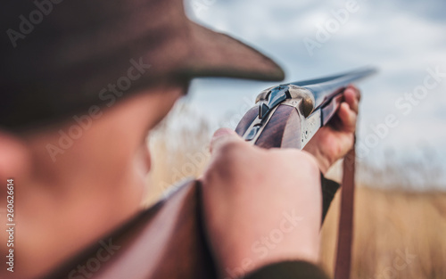 Photo  Hunter with a rifle in hunting