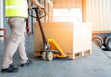 Warehouse Worker Working With Hand Pallet Truck And Shipment Pallet Goods.
