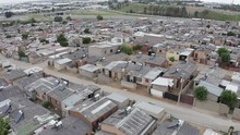4K Aerial Fly Over View Of Low Cost Housing With Solar Water Heaters On Rooftops, South Africa