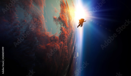 Tablou Canvas Spaceman and planet, human in space concept