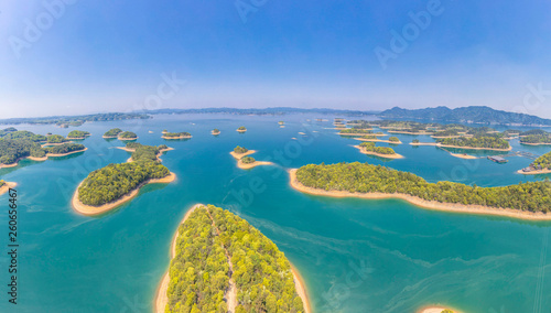Fotografie, Obraz Aerial photography of mini-island in Lushan Sea, inlaid with blue water, is like Jadeite falling jade plate