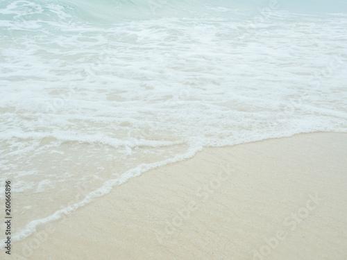 Foto auf Gartenposter Strand Sea water wave and water foam on beach background