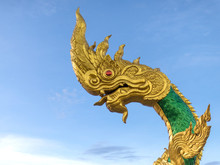 Beautiful Naga Sculpture With Blue Sky On The Sunny Day At The Public Temple
