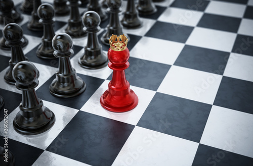 Fotografie, Obraz Red chess pawn wearing a crown standing in front of black chess pieces