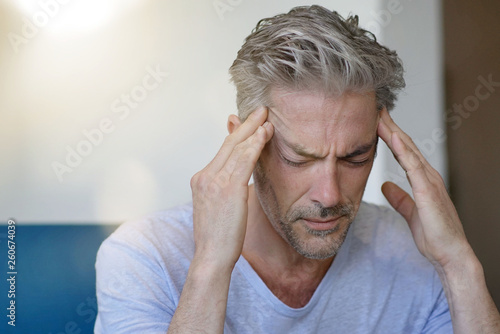 Stampa su Tela Mature man with bad headache at home
