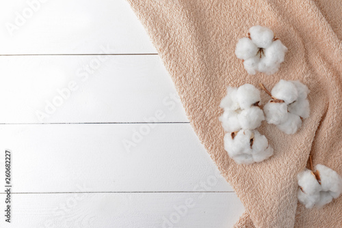Fényképezés Cotton flowers with soft towel on white table