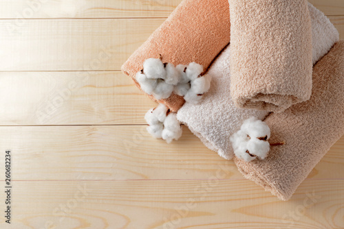Fotografie, Obraz  Cotton flowers with soft towels on wooden table