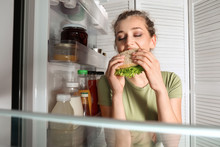 Beautiful Young Woman Eating F...
