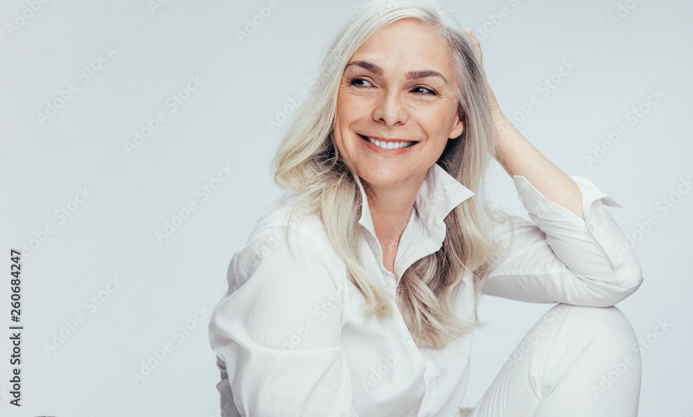 Fototapety, obrazy: Beautiful senior woman looking at copy space
