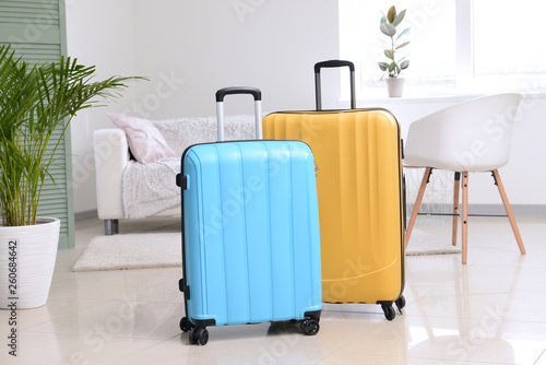 Packed suitcases in room