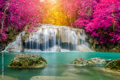 Fototapeta Amazing in nature, beautiful waterfall at colorful autumn forest in fall season obraz