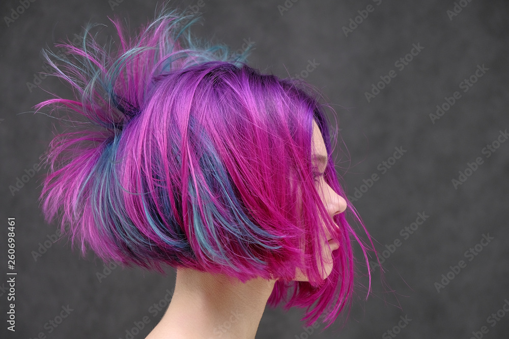 Fototapety, obrazy: Concept Portrait of a punk girl, young woman with chic purple hair color in studio close up on a colorful background with fluttering hair.