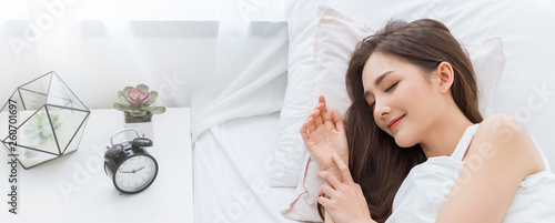 Fotografie, Tablou Portrait of beautiful young sexy asian woman smile enjoy fresh soft bedding linen and mattress in bed room modern apartment